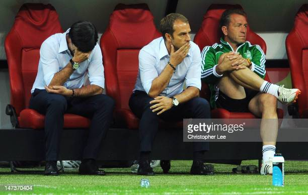 Head coach Joachim Loew of Germany and his assistant coach Hansi Flick show their dejection after the UEFA EURO 2012 semi final match between Germany...