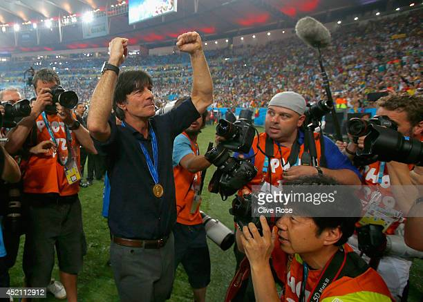 Head coach Joachim Loew of Germany celebrates after defeating Argentina 10 in extra time during the 2014 FIFA World Cup Brazil Final match between...