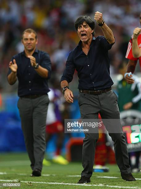 Head coach Joachim Loew of Germany celebrates his team's second goal during the 2014 FIFA World Cup Brazil Group G match between Germany and Ghana at...