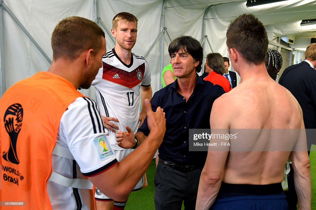 Head coach Joachim Loew (2nd R) of Germany celebrates the 1-0 win with his players Per Mertesacker (2nd L) and Lukas Podolski (1st L) during the 2014 FIFA World Cup Brazil Quarter Final match between France and Germany at Maracana on July 4, 2014 in Rio de Janeiro, Brazil.