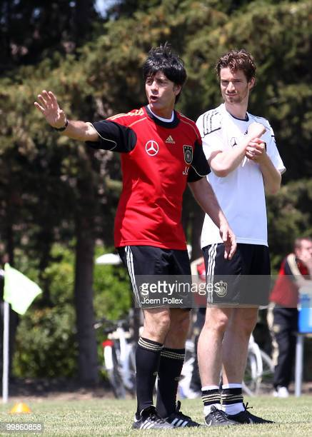 Head coach Joachim Loew of Germany gives instructions to Arne Friedrich during the German National Team training session at Verdura Golf and Spa...