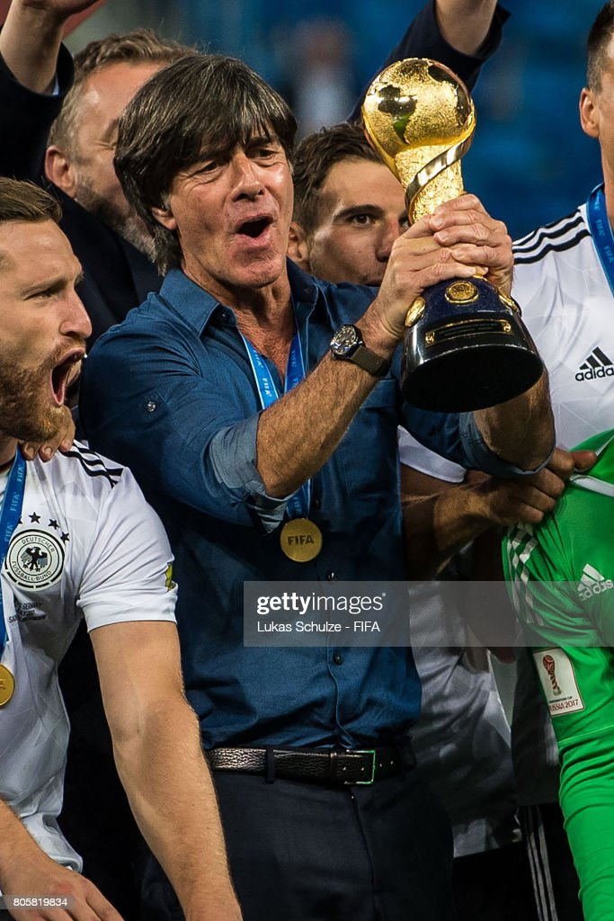 Head Coach Joachim Loew of Germany holds the trophy after winning the FIFA Confederations Cup final match between Chile and Germany at Saint Petersburg Stadium on July 2, 2017 in Saint Petersburg, Russia.