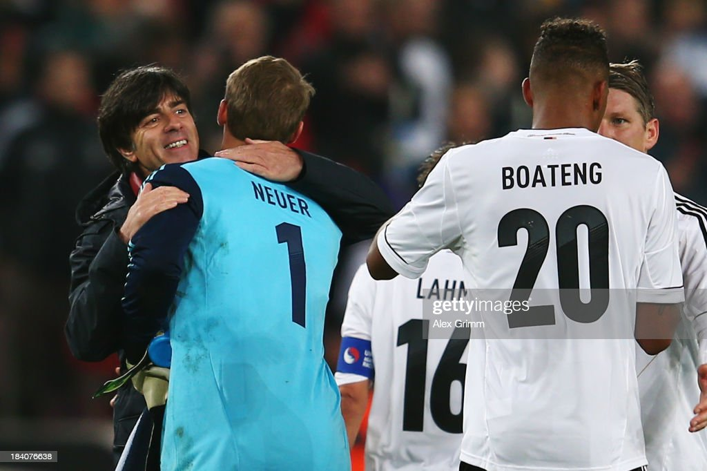 Head coach <a gi-track='captionPersonalityLinkClicked' href=/galleries/search?phrase=Joachim+Loew&family=editorial&specificpeople=215315 ng-click='$event.stopPropagation()'>Joachim Loew</a> of Germany hugs goalkeeper <a gi-track='captionPersonalityLinkClicked' href=/galleries/search?phrase=Manuel+Neuer&family=editorial&specificpeople=764621 ng-click='$event.stopPropagation()'>Manuel Neuer</a> after the FIFA 2014 World Cup Group C qualifiying match between Germany and Republic of Ireland at RheinEnergieStadion on October 11, 2013 in Cologne, Germany.