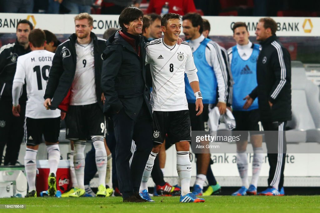 Head coach <a gi-track='captionPersonalityLinkClicked' href=/galleries/search?phrase=Joachim+Loew&family=editorial&specificpeople=215315 ng-click='$event.stopPropagation()'>Joachim Loew</a> of Germany hugs <a gi-track='captionPersonalityLinkClicked' href=/galleries/search?phrase=Mesut+Oezil&family=editorial&specificpeople=764075 ng-click='$event.stopPropagation()'>Mesut Oezil</a> after the FIFA 2014 World Cup Group C qualifiying match between Germany and Republic of Ireland at RheinEnergieStadion on October 11, 2013 in Cologne, Germany.