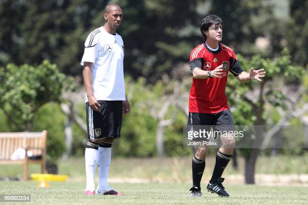Head coach Joachim Loew of Germany instructs Jerome Boateng during the German National Team training session at Verdura Golf and Spa Resort on May 18...