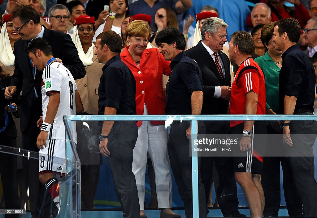 Head coach <a gi-track='captionPersonalityLinkClicked' href=/galleries/search?phrase=Joachim+Loew&family=editorial&specificpeople=215315 ng-click='$event.stopPropagation()'>Joachim Loew</a> of Germany is congratulated by German Chancellor <a gi-track='captionPersonalityLinkClicked' href=/galleries/search?phrase=Angela+Merkel&family=editorial&specificpeople=202161 ng-click='$event.stopPropagation()'>Angela Merkel</a> during the award ceremony after the 2014 FIFA World Cup Brazil Final match between Germany and Argentina at Maracana on July 13, 2014 in Rio de Janeiro, Brazil.