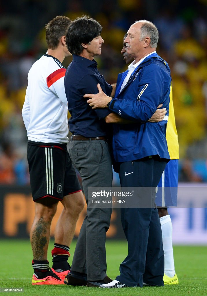 Head coach Joachim Loew (C) of Germany is congratulated the win by Luiz Felipe Scolari of Brazil during the 2014 FIFA World Cup Brazil Semi Final match between Brazil and Germany at Estadio Mineirao on July 8, 2014 in Belo Horizonte, Brazil.