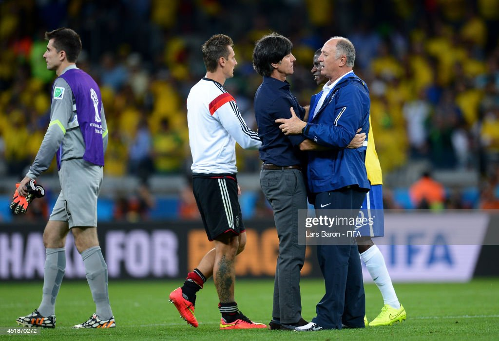 Head coach Joachim Loew (2nd R) of Germany is congratulated the win by Luiz Felipe Scolari (1st R) of Brazil after the 2014 FIFA World Cup Brazil Semi Final match between Brazil and Germany at Estadio Mineirao on July 8, 2014 in Belo Horizonte, Brazil.