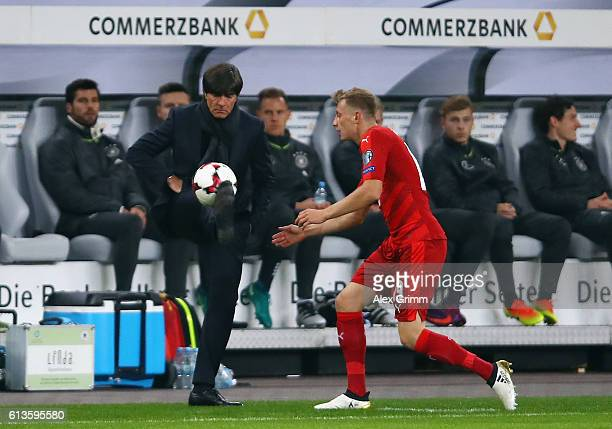Head coach Joachim Loew of Germany juggles with the ball during the FIFA World Cup 2018 qualifying match between Germany and Czech Republic at...