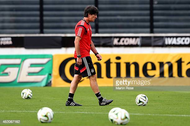 Head coach Joachim Loew of Germany looks on during the Germany training session ahead of the 2014 FIFA World Cup Final at Estadio Sao Januario on...