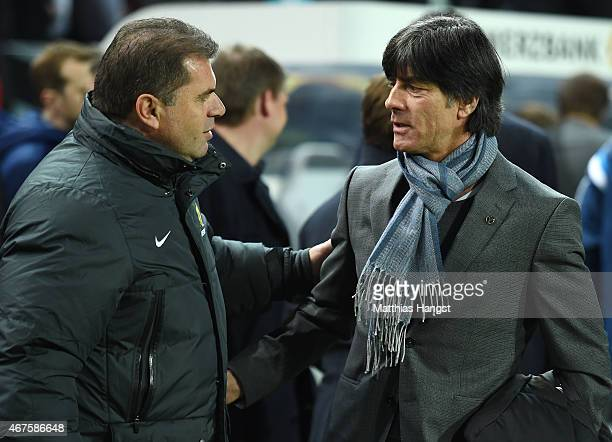 Head coach Joachim Loew of Germany meets with head coach Ange Postecoglou of Australia prior to the International Friendly match between Germany and...