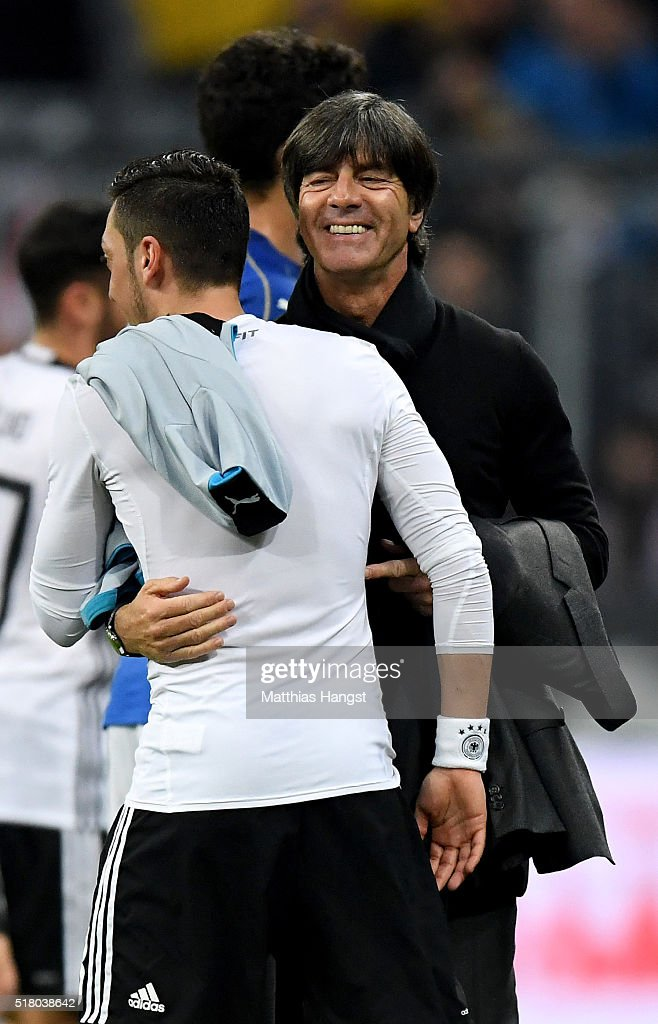 Head coach <a gi-track='captionPersonalityLinkClicked' href=/galleries/search?phrase=Joachim+Loew&family=editorial&specificpeople=215315 ng-click='$event.stopPropagation()'>Joachim Loew</a> of Germany smiles after winning the International Friendly match between Germany and Italy at Allianz Arena on March 29, 2016 in Munich, Germany.