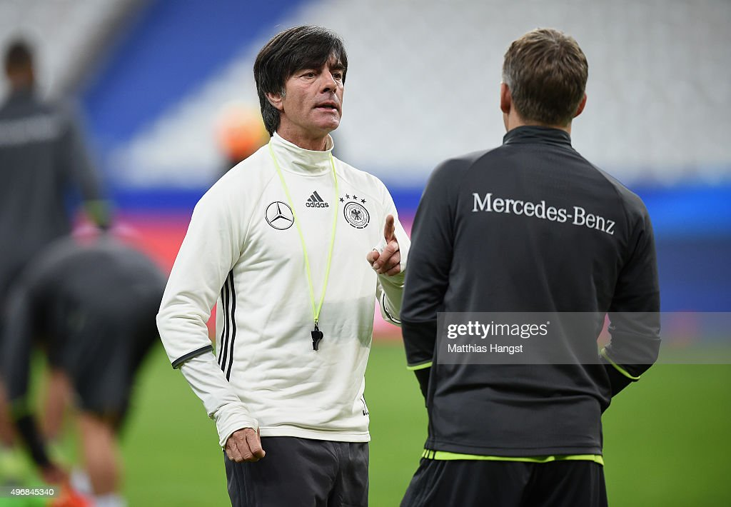 Head coach Joachim Loew of Germany speaks to Bastian Schweinsteiger of Germany during a Germany training session ahead of their International Friendly against France at Stade de France on November 12, 2015 in Paris, France.