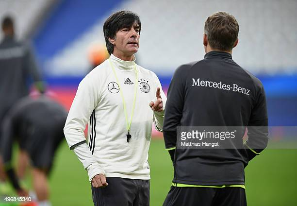 Head coach Joachim Loew of Germany speaks to Bastian Schweinsteiger of Germany during a Germany training session ahead of their International...