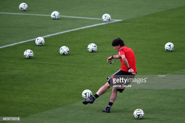 Head coach Joachim Loew of Germany take a shot on goal during the Germany training session ahead of the 2014 FIFA World Cup Final at Estadio Sao...