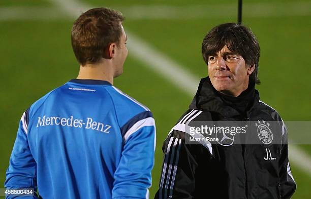 Head coach Joachim Loew of Germany talks to goalkeeper Manuel Neuer during a training session ahead of the EURO 2016 Group D qualifying match against...
