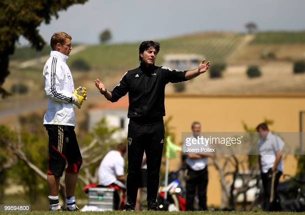 Head coach Joachim Loew of Germany talks to goalkeeper Manuel Neuer of Germany during the German National Team training session at Verdura Golf and...