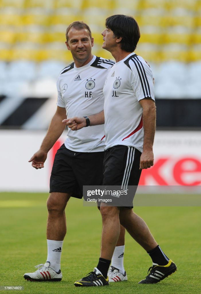 Head Coach <a gi-track='captionPersonalityLinkClicked' href=/galleries/search?phrase=Joachim+Loew&family=editorial&specificpeople=215315 ng-click='$event.stopPropagation()'>Joachim Loew</a> (R) of Germany talks to his assistant coach <a gi-track='captionPersonalityLinkClicked' href=/galleries/search?phrase=Hans-Dieter+Flick&family=editorial&specificpeople=2439902 ng-click='$event.stopPropagation()'>Hans-Dieter Flick</a> during a Germany Training Session at Allianz Arena Munich on September 5, 2013 in Munich, Germany.