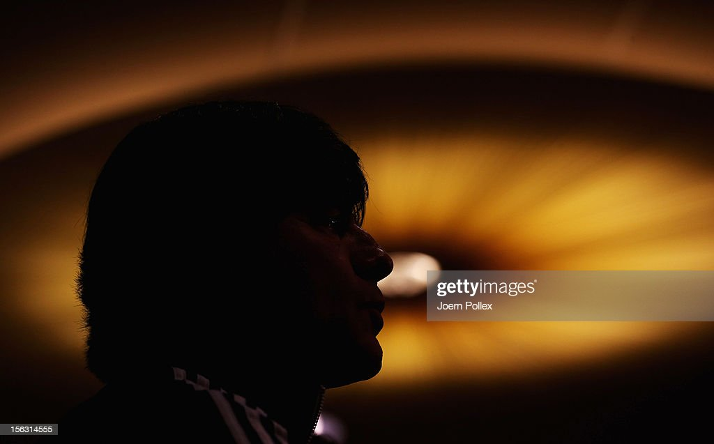 Head coach <a gi-track='captionPersonalityLinkClicked' href=/galleries/search?phrase=Joachim+Loew&family=editorial&specificpeople=215315 ng-click='$event.stopPropagation()'>Joachim Loew</a> of Germany talks to the media during a press conference, on the eve of their friendly international match against the Netherlands, at Marriot Hotel on November 13, 2012 in Amsterdam, Netherlands.