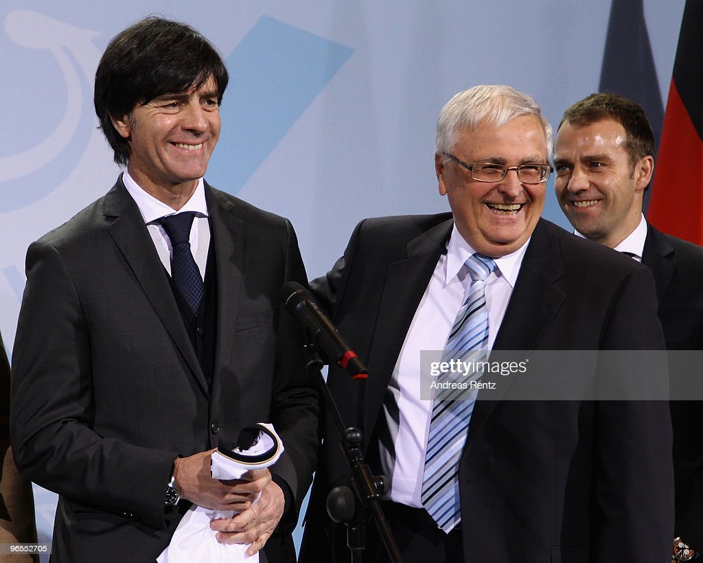 Merkel Receives German FIFA World Cup 2010 Jersey 'Teamgeist'