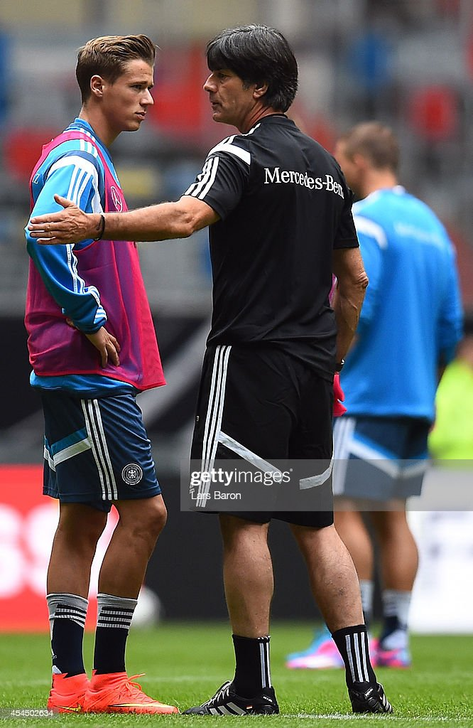 Head coach <a gi-track='captionPersonalityLinkClicked' href=/galleries/search?phrase=Joachim+Loew&family=editorial&specificpeople=215315 ng-click='$event.stopPropagation()'>Joachim Loew</a> speaks with <a gi-track='captionPersonalityLinkClicked' href=/galleries/search?phrase=Erik+Durm&family=editorial&specificpeople=8218660 ng-click='$event.stopPropagation()'>Erik Durm</a> during a Germany training session at Esprit Arena on September 2, 2014 in Duesseldorf, Germany.