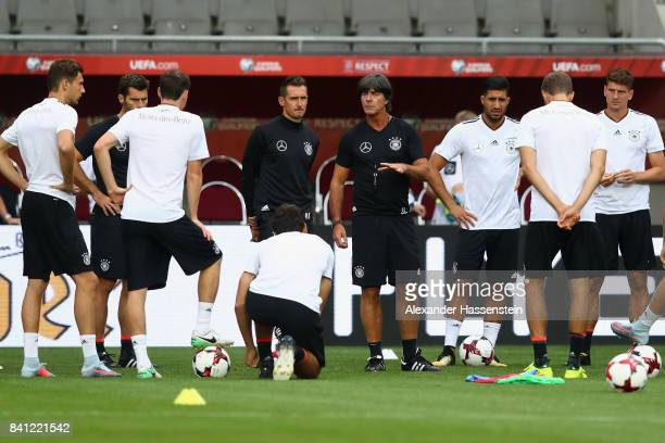 Head coach Joachim Loew talks to the players during a Germany training session at Eden Arena ahead of their FIFA World Cup Russia 2018 Group C...