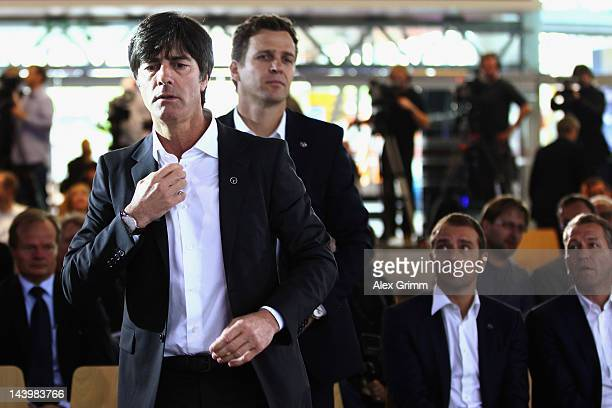 Head coach Joachim Loew team manager Oliver Bierhoff assistant coach HansDieter Flick and goalkeeper coach Andreas Koepke wait for the start of the...