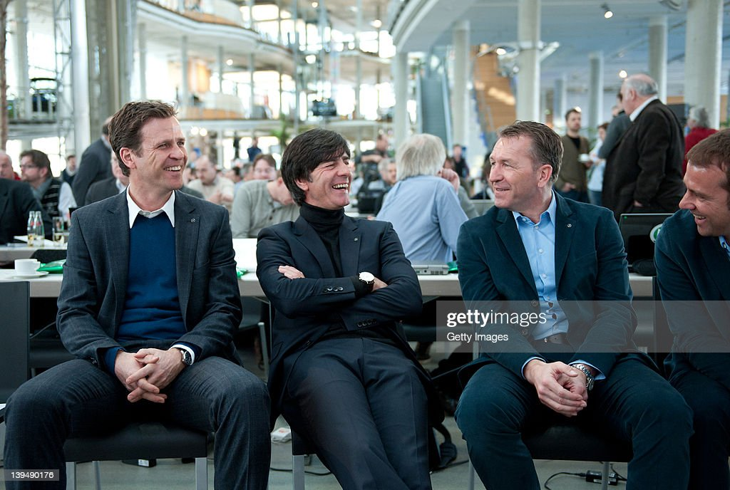 Head coach <a gi-track='captionPersonalityLinkClicked' href=/galleries/search?phrase=Joachim+Loew&family=editorial&specificpeople=215315 ng-click='$event.stopPropagation()'>Joachim Loew</a> (2nd L), team manager <a gi-track='captionPersonalityLinkClicked' href=/galleries/search?phrase=Oliver+Bierhoff&family=editorial&specificpeople=213661 ng-click='$event.stopPropagation()'>Oliver Bierhoff</a> (L), goalkeeper coach Andreas Koepke and assistant coach Hansi Flick of Germany smile during a DFB EURO 2012 press conference at Mercedes Benz World on February 22, 2012 in Berlin, Germany.