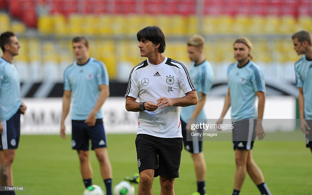 Head Coach <a gi-track='captionPersonalityLinkClicked' href=/galleries/search?phrase=Joachim+Loew&family=editorial&specificpeople=215315 ng-click='$event.stopPropagation()'>Joachim Loew</a> watches his players during a Germany Training Session at Allianz Arena Munich on September 5, 2013 in Munich, Germany.