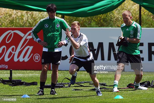 Head coach Joachim Loew watches Marco Reus exercise during a Germany training session at Campo Sportivo Comunale Andrea Dora on May 14 2012 in Olbia...