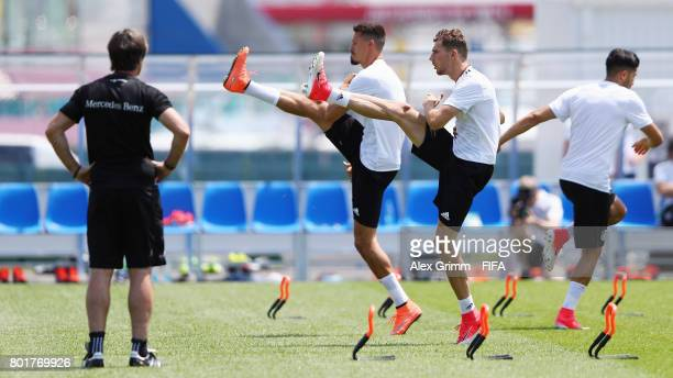 Head coach Joachim Loew watches Sandro Wagner and Leon Goretzka exercise during a Germany training session at Sotchi Parc Arena ahead of their FIFA...