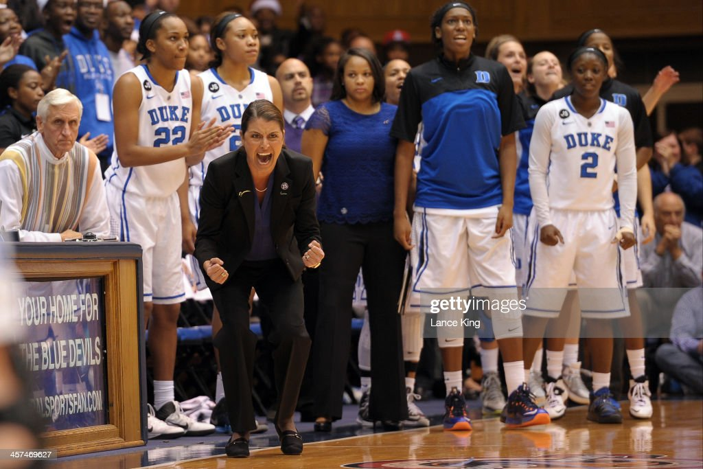 Head Coach Joanne P. McCallie of the Duke Blue Devils encourages her team against the Connecticut Huskies at Cameron Indoor Stadium on December 17, 2013 in Durham, North Carolina. Connecticut defeated Duke 83-61.