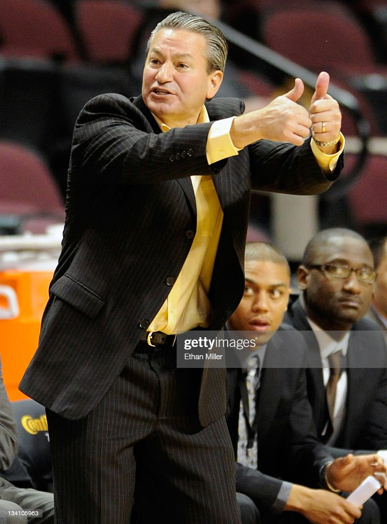 Head coach Joe Callero of the Cal Poly Mustangs argues an official's call as his team takes on the Morgan State Bears during the third round of the Continental Tire Las Vegas Invitational at the Orleans Arena November 25, 2011 in Las Vegas, Nevada. Cal Poly won 62-61.
