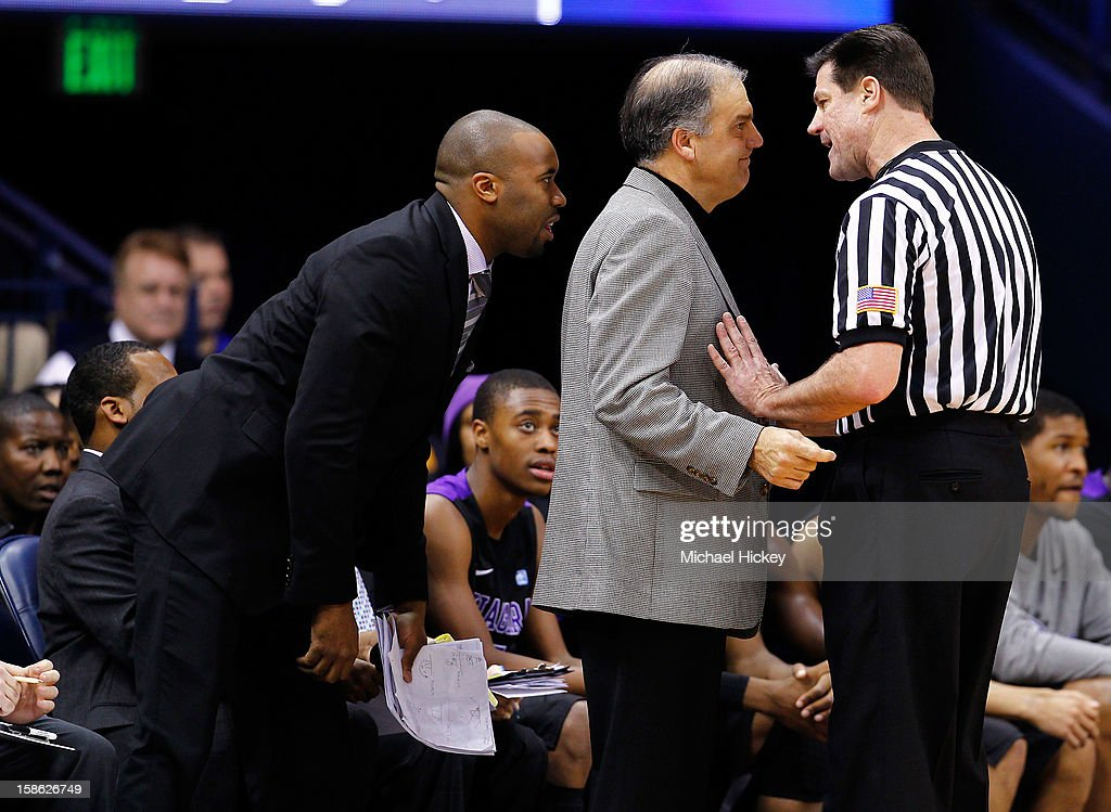 Head coach Joe Mihalich of the Niagara Purple Eagles confers with officials during action against the Notre Dame Fighting Irish at Purcel Pavilion on December 21, 2012 in South Bend, Indiana.