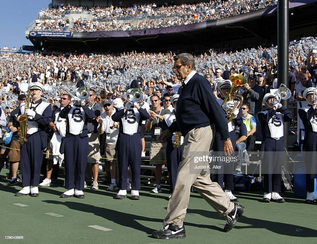 Head coach Joe Paterno of the Penn State Nittany Lions walks onto the field against the Iowa Hawkeyes during the game on October 8, 2011 at Beaver Stadium in State College, Pennsylvania.