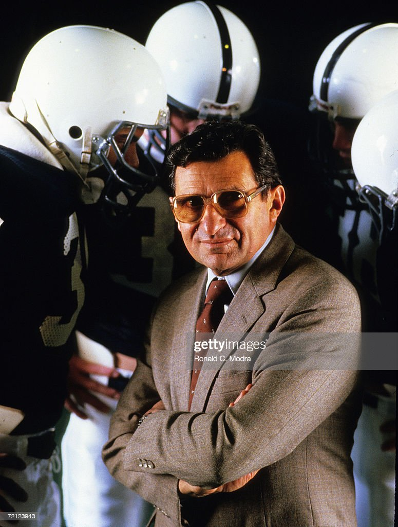 Head Coach <a gi-track='captionPersonalityLinkClicked' href=/galleries/search?phrase=Joe+Paterno&family=editorial&specificpeople=623059 ng-click='$event.stopPropagation()'>Joe Paterno</a> of the Penn State Nittany Lions with some players in the background during the 12-0 1986 season on December 22, 1986 in University Park, Pennsylvania.