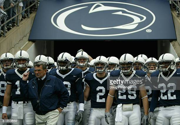 Head coach Joe Paterno of the Penn State Nittnay Lions leads his team onto the field as the Iowa Hawkeyes defeated Penn State Nittnay Lions 64 during...