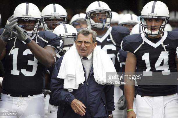 Head coach Joe Paterno walks onto the field with Defensive Tackle Jay Alford and Quarterback Anthony Morelli of the Penn State Nittany Lions prior to...