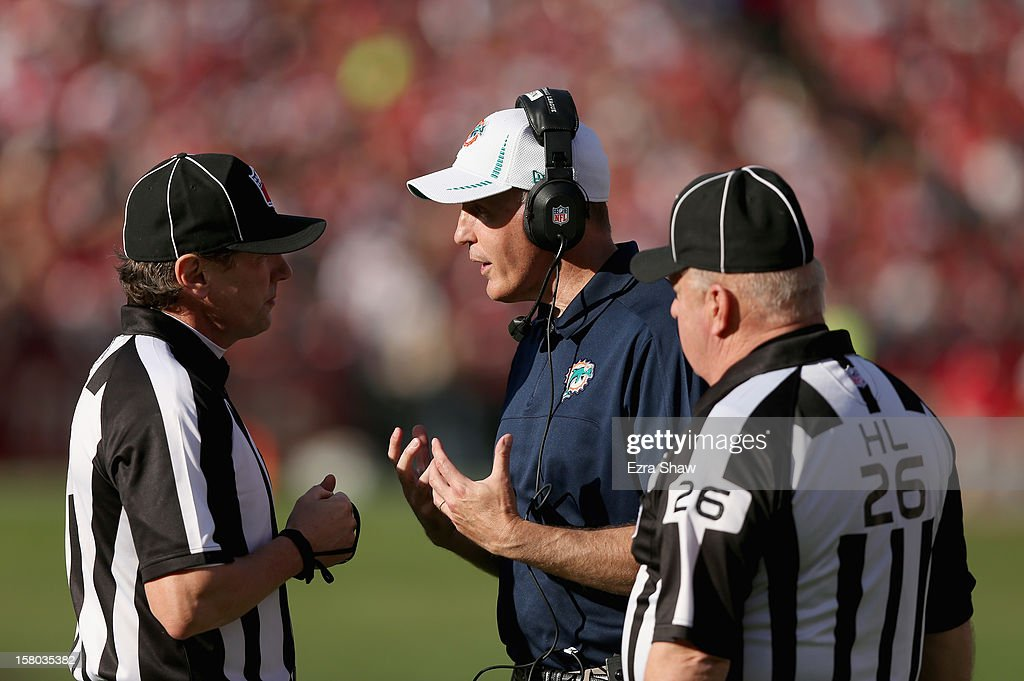 Head coach Joe Philbin of the Miami Dolphins argues a call with the officials during their game against the San Francisco 49ers at Candlestick Park on December 9, 2012 in San Francisco, California.