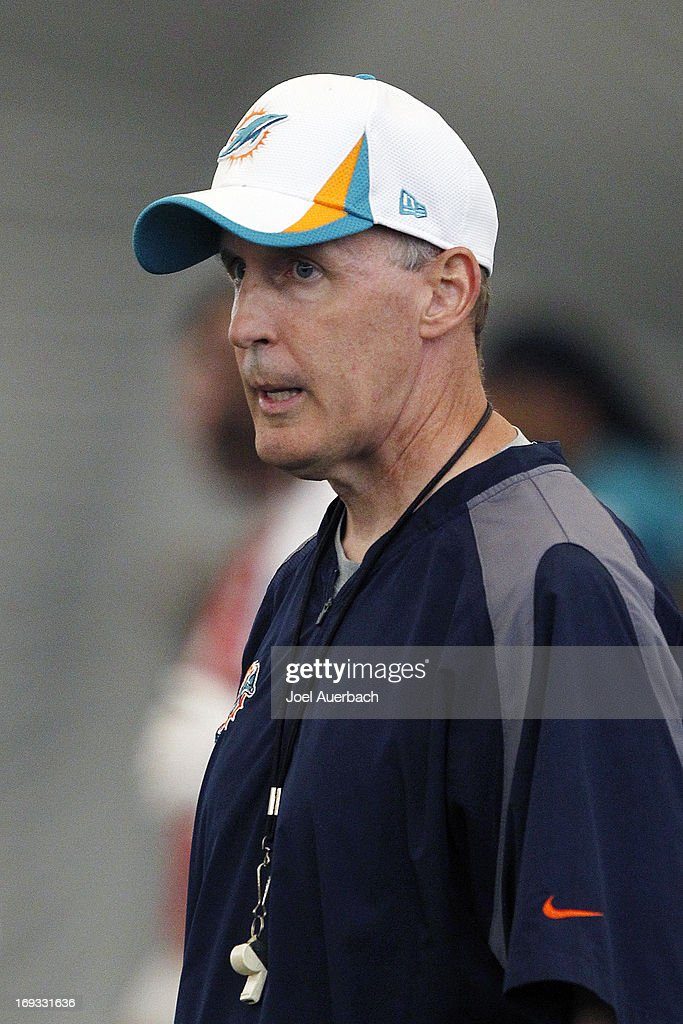 Head coach <a gi-track='captionPersonalityLinkClicked' href=/galleries/search?phrase=Joe+Philbin&family=editorial&specificpeople=2331822 ng-click='$event.stopPropagation()'>Joe Philbin</a> of the Miami Dolphins directs the players during the first team OTA on May 21, 2013 at the Miami Dolphins training facility in Davie, Florida.
