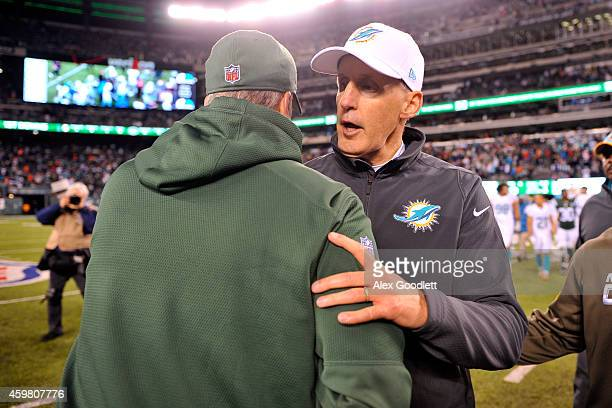 Head coach Joe Philbin of the Miami Dolphins shakes hands with head coach Rex Ryan of the New York Jets after their game at MetLife Stadium on...