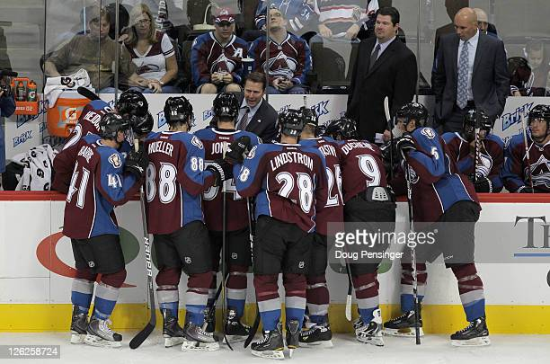 Head coach Joe Sacco directs the Colorado Avalanche during a time out against the St Louis Blues as assistant coaches Adam Deadmarsh and Sylvain...