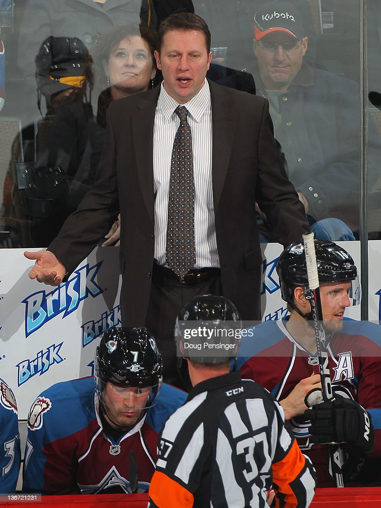 Head coach Joe Sacco of the Colorado Avalanche talks with referee Kyle Rehman as the Avalanche were defeated by the Nashville Predators 4-1 at the Pepsi Center on January 10, 2012 in Denver, Colorado.