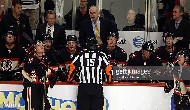 Head coach Joel Quenneville of the Chicago Blackhawks argues with referee Stephane Auger after a goal against the Minnesota Wild was waved off as...