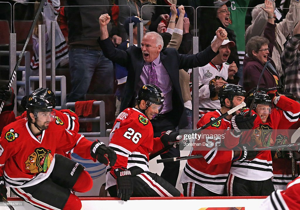 Head coach <a gi-track='captionPersonalityLinkClicked' href=/galleries/search?phrase=Joel+Quenneville&family=editorial&specificpeople=2094832 ng-click='$event.stopPropagation()'>Joel Quenneville</a> of the Chicago Blackhawks celebrates an overtime win against the St. Louis Blues as members of his team jump from the bench onto the ice in Game Four of the First Round of the 2014 NHL Stanley Cup Playoffs at the United Center on April 23, 2014 in Chicago, Illinois. The Blackhawks defeated the Blues 4-3 in overtime.