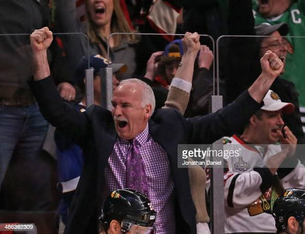 Head coach Joel Quenneville of the Chicago Blackhawks celebrates an overtime win against the St Louis Blues in Game Four of the First Round of the...