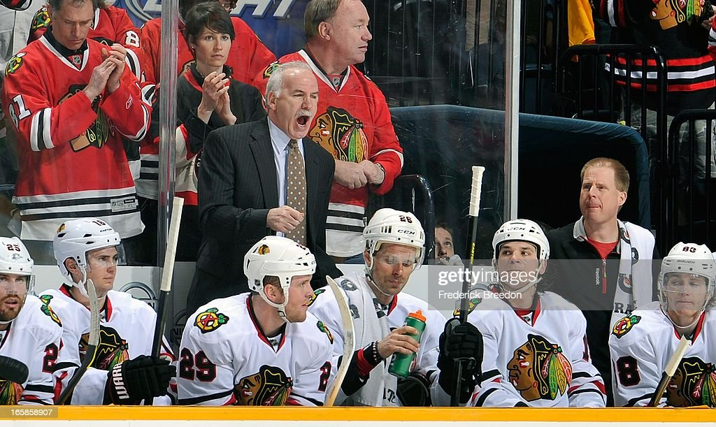 Head coach <a gi-track='captionPersonalityLinkClicked' href=/galleries/search?phrase=Joel+Quenneville&family=editorial&specificpeople=2094832 ng-click='$event.stopPropagation()'>Joel Quenneville</a> of the Chicago Blackhawks coaches his team against the Nashville Predators at the Bridgestone Arena on April 6, 2013 in Nashville, Tennessee.