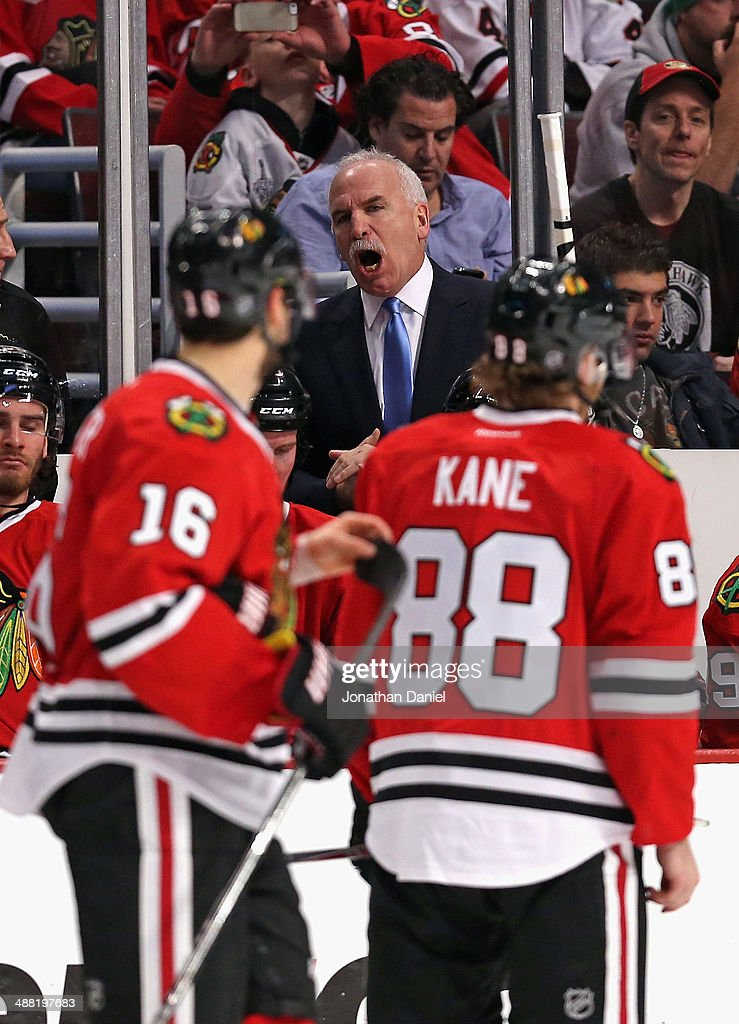 Head coach Joel Quenneville of the Chicago Blackhawks gives instructions to his team against the Minnesota Wild in Game Two of the Second Round of the 2014 NHL Stanley Cup Playoffs at the United Center on May 4, 2014 in Chicago, Illinois. The Blackhawks defeated the Wild 4-1.
