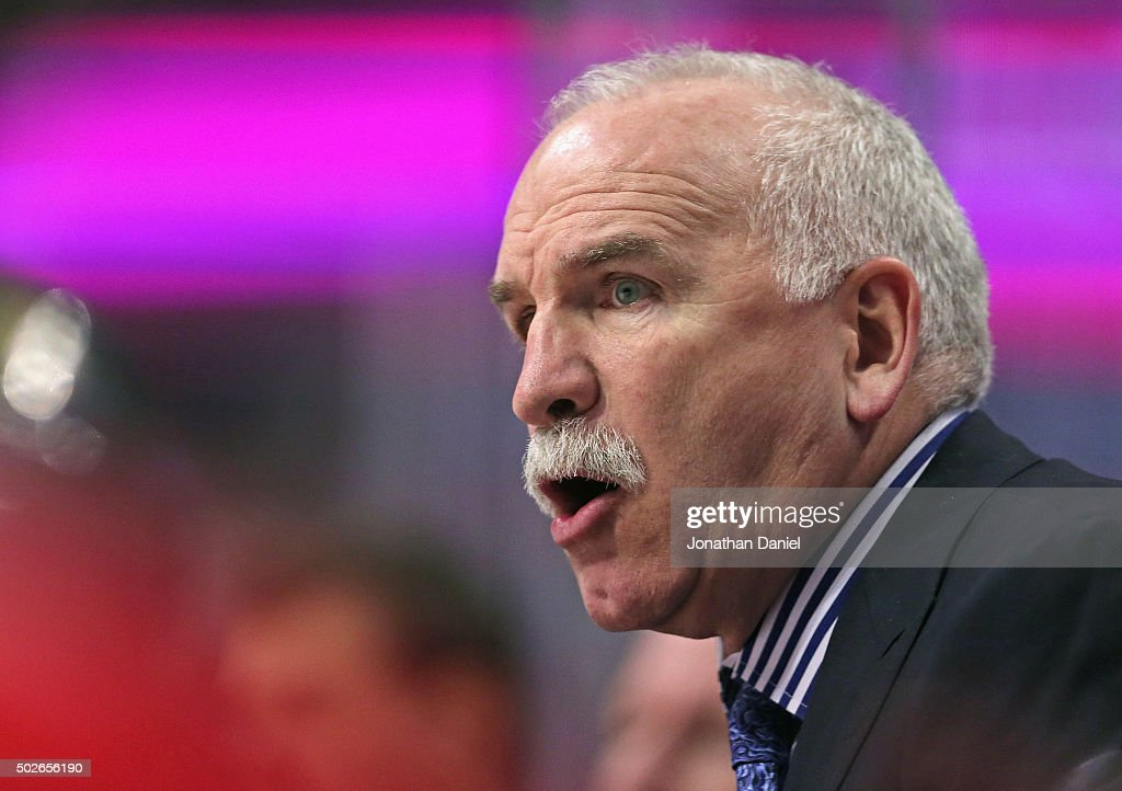 Head coach <a gi-track='captionPersonalityLinkClicked' href=/galleries/search?phrase=Joel+Quenneville&family=editorial&specificpeople=2094832 ng-click='$event.stopPropagation()'>Joel Quenneville</a> of the Chicago Blackhawks gives instructions to his team against the Carolina Hurricanes at the United Center on December 27, 2015 in Chicago, Illinois. The Hurricanes defeated the Blackhawks 2-1.