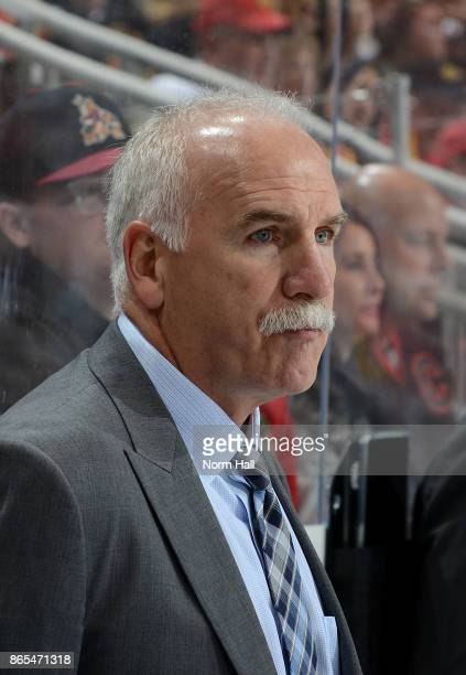Head coach Joel Quenneville of the Chicago Blackhawks looks on from the bench during a game against the Arizona Coyotes at Gila River Arena on...